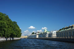 City channel view. A daylight image of St. Petersburg city channel with a park and some historical buildings Royalty Free Stock Images