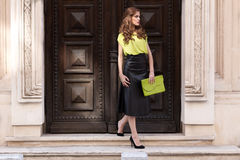 City chic girl with neon blouse Stock Photography
