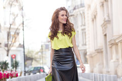 City chic girl with neon blouse Stock Photos