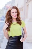 City chic girl with neon blouse Royalty Free Stock Photography