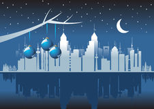 City at christmas. Christmas balls over city skyline with reflex Royalty Free Stock Photography