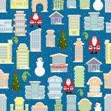 City Christmas landscape. New year city. Snowfall and skyscraper Stock Photos