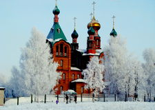 The city church. Stands on a hill covered with snow Royalty Free Stock Photo