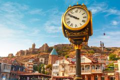 City clock and Narikala fortress, Tbilisi, Georgia Royalty Free Stock Photography