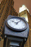 City Clock and Skyscrapers. An old fashion clock in downtown Manhattan with skysrcrapers behind it Stock Images
