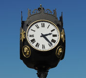 The city clock. Urban street clock  against the blue sky Stock Images