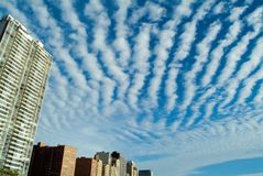 City Clouds. City buildings skyline with dramatic clouds stock photography