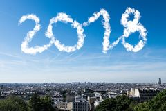 The city with clouds in the sky make 2018 number. royalty free stock photography