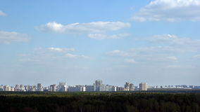 City clouds timelapse. An urban landscape with clouds timelapse stock footage