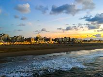 City coastline with buildings of the beach in Scheveningen the Netherlands a popular touristic town. A city coastline with buildings of the beach in Scheveningen stock image
