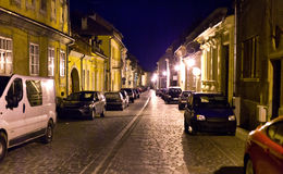 City cobblestone street at night Stock Images