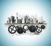 City with cogwheel Stock Photo