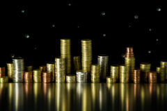 City of coins. A little city made of various Euro coins on black background Stock Photos