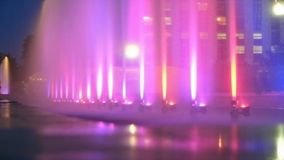 City color fountain as background. Photography with scene city evening fountain violet color royalty free stock photography