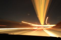 City colorful night lights perspective blurred by high speed of the car. A streak of light, trails in USA Stock Photos