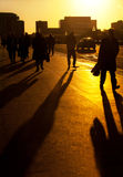 City commuters. Silhouette of business people and commuters travelling to work at sunrise Stock Photos