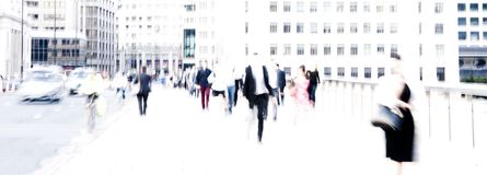City commuters. High key blurred image of city commuters going back home after work. Unrecognizable faces, bleached effect Stock Photography