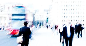 City commuters. High key blurred image of city commuters going back home after work. Unrecognizable faces, bleached effect Stock Photos