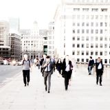 City Commuters. High key blurred image of workers walking in the city. Unrecognizable faces, bleached effect Stock Photos