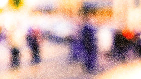 City commuters in winter. Winter city commuters with snow. Blurred image of peaople walking on the street. back home after work. Defocused figures of people with Royalty Free Stock Image
