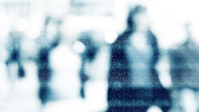 City commuters in winter. Winter city commuters with snow. Blurred image of people walking on the street. back home after work. Defocused figures of people with Royalty Free Stock Photo