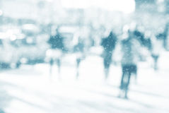 City commuters in winter. Winter city commuters with snow. Blurred image of people walking on the street. back home after work. Defocused figures of people with Royalty Free Stock Photos