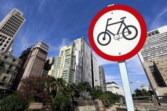 Bicycle traffic permission board between buildings in perspectiv. City concept : bicycle traffic permission board between buildings in perspective Stock Photos