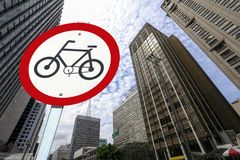 Bicycle traffic permission board between buildings in perspectiv. City concept : bicycle traffic permission board between buildings in perspective Royalty Free Stock Images