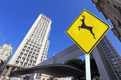 City concept: wild animals warning with city image in background Imagenes de archivo