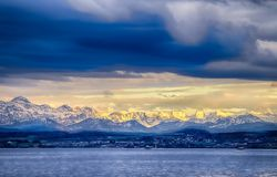 The city Constance on the Lake Constace, Bodensee. The view of sunset at the snowy mountains Alps. Thelake lies in Germany, royalty free stock image