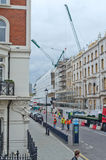 City construction. A building being restored or repaired, in a modern town setting. Great for articles on current construction industry Stock Image