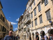 Shopping in Corfu town on the Island of Corfu. The city of Corfu stands on the broad part of a peninsula, whose termination in the Venetian citadel is cut off Stock Photos