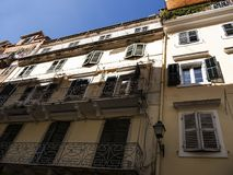 Buildings in Corfu town on the Greek Island of Corfu. The city of Corfu stands on the broad part of a peninsula, whose termination in the Venetian citadel is cut Stock Photo