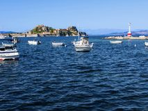 Boats in the bay of Corfu Town on  the Greek Island of Corfu Royalty Free Stock Photos