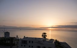 Sunrise over the bay over the main town on the the Greek island of Corfu. The city of Corfu stands on the broad part of a peninsula, whose termination in the Royalty Free Stock Photo