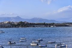 Panorama of the Bay at Corfu town on the the Greek island of Corfu. The city of Corfu stands on the broad part of a peninsula, whose termination in the Venetian Royalty Free Stock Photo