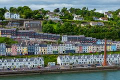 Cobh Lighthouse and Colorful Houses stock photo