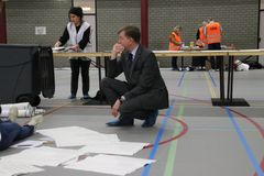 City council elections Netherlands 2018 : mayor Kats is checkinballots counted and sorted in big sportfacilitiy in the Netherlands stock photography