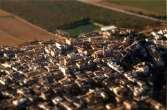 City and countryside, tiltshift. Aerial view of tilt shift cityscape and countryside fields. tiltshift Stock Photography