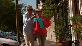 City couple window shopping on sunny day stock video