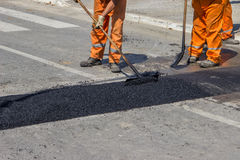 City crew install a new speed bump 4 Stock Images
