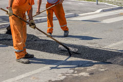 City crew install a new speed bump 3. City crew install a new speed bump for slowing traffic near school. Selective focus Royalty Free Stock Image
