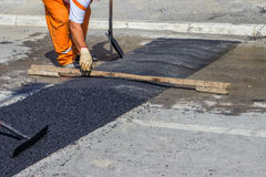 City crew install a new speed bump Royalty Free Stock Image