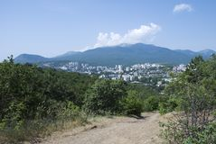 City in the Crimean mountains. With road in the foreground royalty free stock photography