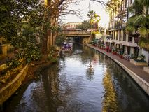 A city crossed by a river. This photo was taken in the winter of 2007 in the city of San Antonio, Texas, U.S.A. It`s a beautiful city. The San Antiono River is stock photography