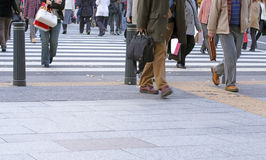 City crowd. People crossing the street in a big city-very low perspective and soft focus Royalty Free Stock Images