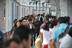 City Crowd. People walk along a crowded city center pedestrian walkway on May 8, 2013 in Bangkok, Thailand. Metropolitan Bangkok is home to approximately 15 Royalty Free Stock Photography