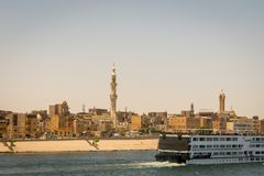 City and cruise on the banks of the Nile. Egypt. April 2019. Country, cityscape, muslim, nilo, village, water, africa, architecture, boat, circumscription stock photography