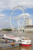 City Cruise Boat and London Eye on River Thames Stock Photo