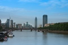 City cruise ships on the river Thames, on background Lambeth  Br. City cruise ships on the river Thames, on background Lambert  Bridge and London Towers  in the Royalty Free Stock Images